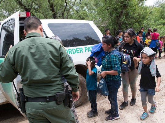 U.S. Border Patrol agents take a group of migrant families to a safer place to be transported after intercepting them near McAllen, Texas.