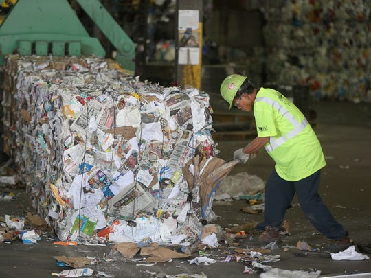 Bales of paper get one more  check for contaminants