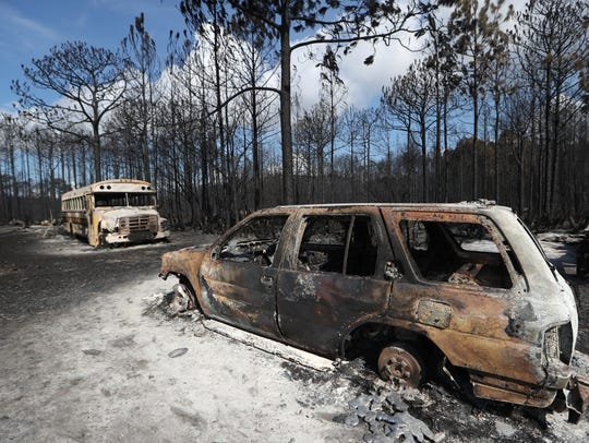 Vehicles that have been burned out are left destroyed