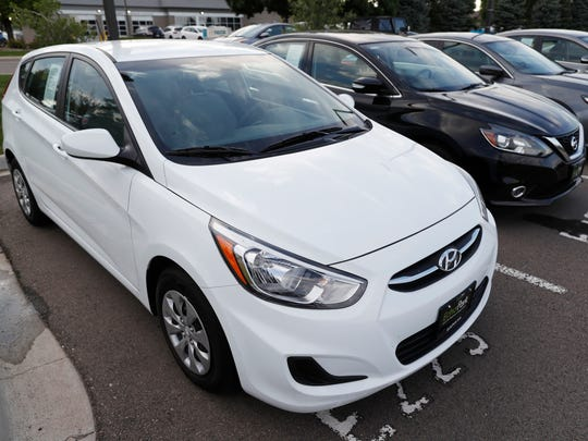 A used 2017 Hyundai Accent hatchback sits in a row