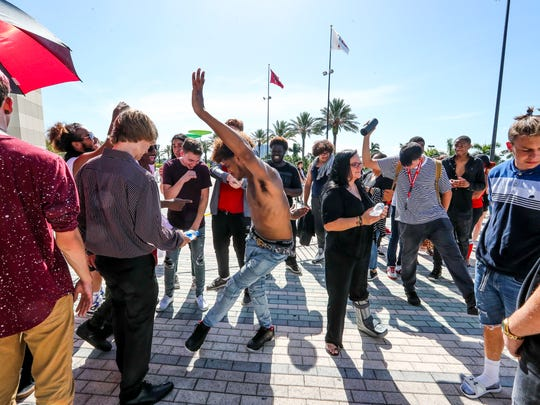 Rafael Correa, 19 of Kissimmee, Fla., dances to the music of XXXTentacion as fans waited to get into his memorial viewing on June 27, 2018, in Sunrise, Fla.