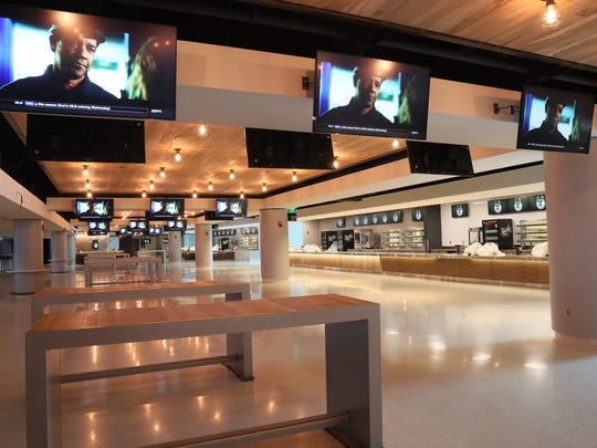 TVs line the concourse at the new Bucks arena.