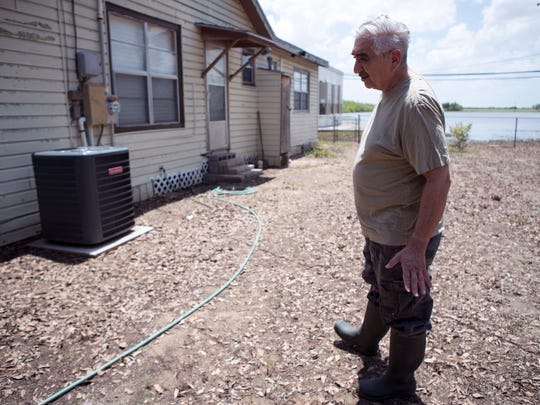 Joe Lopez talks about the damage done to his home by recent rains in Premont. A nearby lake has formed and the city has been pumping the water that gathered as 21 inches of rain fell over a few days. Lopez said Thursday, June 28, 2018 that he hopes the city and county will be able to get the state to issue a disaster declaration. He and his wife don't have flood insurance, they are not in a flood zone, he said.