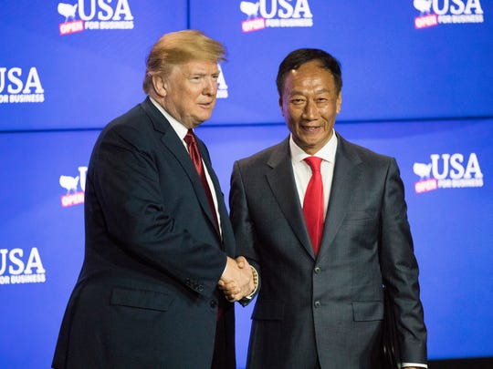 President Donald Trump greets Foxconn Technology Group's then-chairman Terry Gou June 28, 2018, in Mount Pleasant. Gou visited Milwaukee on Friday after a White House meeting with Trump on Thursday at which the men discussed Foxconn's Wisconsin project.