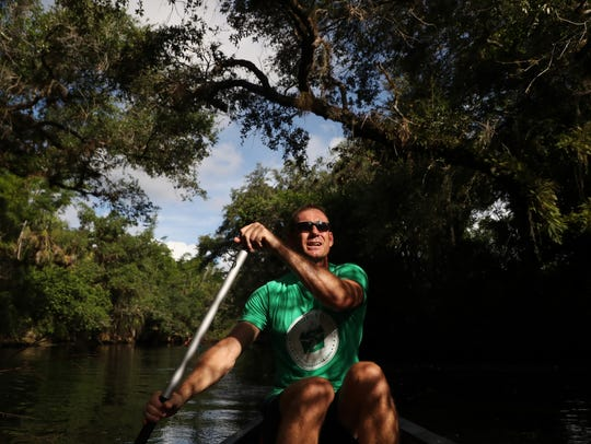 Cape Coral resident Eric Elseay  paddles on the Estero River. Lands that are now the headwaters of the river are developed and recently showed elevated levels of Enterrococci bacteria.