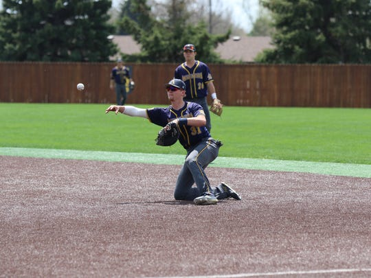 Augustana first baseman Jordan Barth (31) makes a throw to first this season. Barth, a Rocori High School graduate, moved to first base after playing shortstop throughout his career.