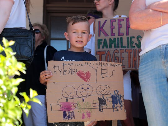 Issac Nelsen, 5, with his sign at the Palm Springs