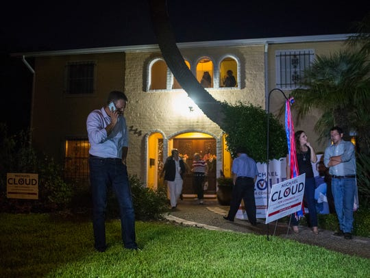Republican Michael Cloud talks on the phone after winning