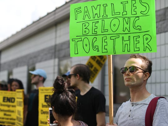 People gather Saturday outside of the Wakulla Sheriff's Office in Crawfordville, Fla., home to an ICE detention facility, as part of the nationwide Families Belong Together rally to protest the separation and detention of migrant families by the U.S. federal government.