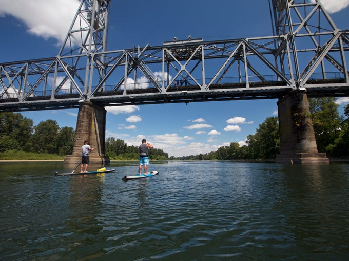 Tod Woodward paddles his stand-up paddleboard on the