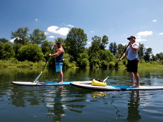 Tod Woodward paddles his stand-up paddleboard on the Willamette River.