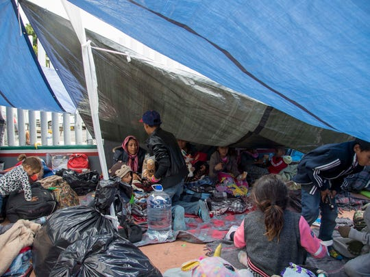 About a dozen tents have been set up on the cement outside the entrance gate to the San Ysidro port providing some protection from cloudy skies and intermittent rain on May 1, 2018. The migrants are now hunkered down for the long haul. Volunteers from various organizations in Tijuana continue to drop off food, water, diapers, and clothing.