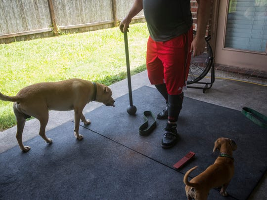 Alan Krockover trains on his back porch on Thursday,