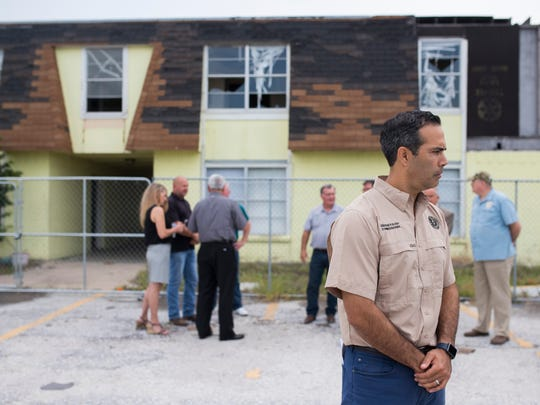 Texas Land Commissioner George P. Bush stands outside the Oak Harbor Apartments in Rockport on Friday, July 6, 2018. The the multi-family apartment complex was severely damaged by Hurricane Harvey.