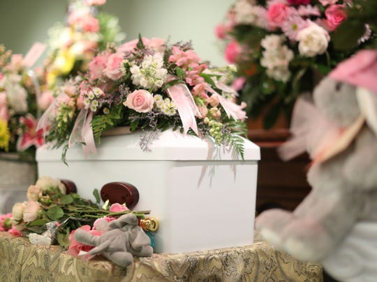 A funeral service for Baby Jane Doe, the newborn who was discovered dead in a dumpster Feb. 16 at Rolling Hills Apartments on John Knox Road, at the Bevis Funeral Home on June 27, a short distance from where her body was found.