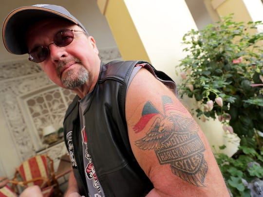 Gary Radmer of Slinger shows off his tattoo with the Czech Republic flag and the American flag that he got for the Harley-Davidson 115th anniversary celebration in Prague.