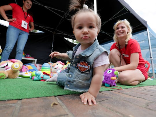 Maria Elena, 11 months, plays in the Family Paradise area at the Holesovice Exhibition Grounds in Prague.