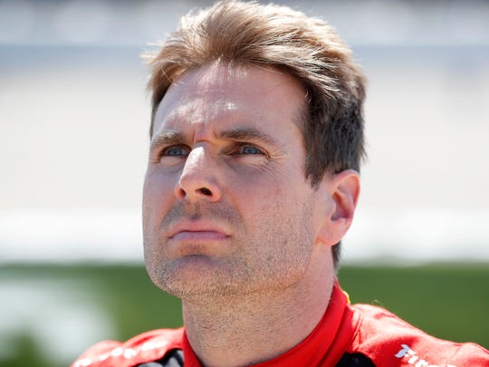 Will Power watches qualifying for the IndyCar Series auto race Saturday, July 7, 2018, at Iowa Speedway in Newton, Iowa. (AP Photo/Charlie Neibergall)