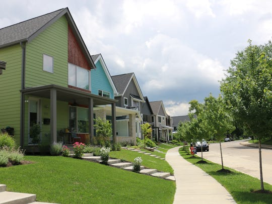 Carefully maintained homes and lawns line a street
