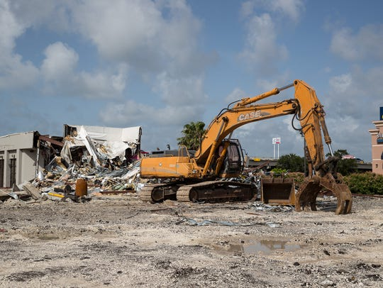 A former Taco Cabana building is being demolished at Moore Plaza on Monday, July 9, 2018. A Raising Cane's chicken restaurant will be built in its place.