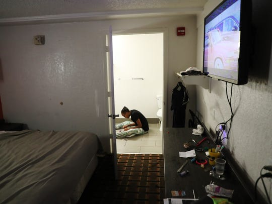 In a North Fort Myers motel room, Lucy Tapia prepares