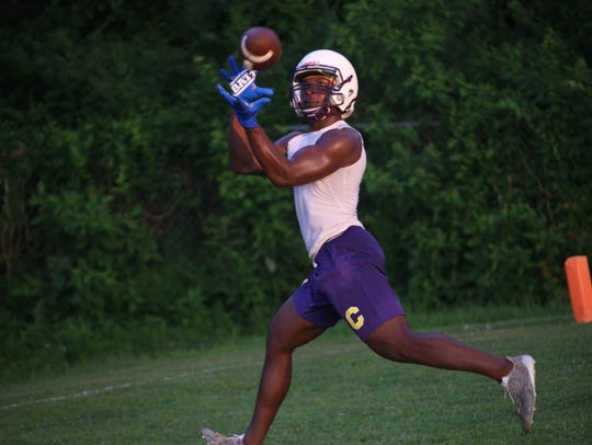 Clarksville High's Josh Watch catches the ball in the