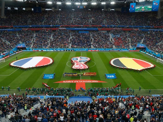 The teams of France, left, and Belgium stand for the