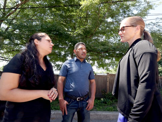 Enrique Lopez Perez of Mount Kisco talks with interpreter Ana Merchan, left, and  Karin Anderson Ponzer, director of legal services for Neighbors Link, an immigrant advocacy group based in Mount Kisco July 10 .2018. Perez was arrested and detained by Immigration and Customs Enforcement officers in April when they showed up at his home looking for another individual, who wasn't present. Perez was arrested and spent over two months detained in the Orange County jail before Neighbors Link was able to convince a judge to release him on bond.