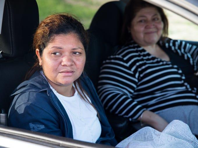 Cindy Alinette Madrid-Henriquez sits in a car outside
