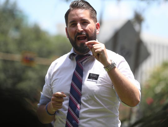 Mayoral candidate Dustin Daniels addresses a crowd in favor of smokable medical marijuana during a protest at the Capitol on Wednesday, July 11, 2018.