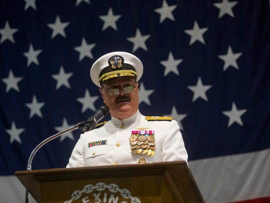 Rear Adm. Gregory Harris speaks during a changing of