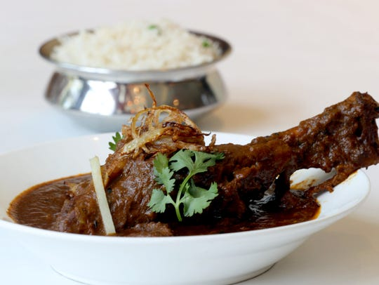 Awadhi Dum, a roasted lamb shank, is one of the items