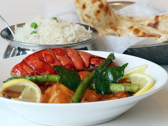 Samunder Se, which is lobster, scallops, and shrimp in a coconut milk sauce with indian spices, is one of the items on the menu at RaaSa, an Indian restaurant in Elmsford, photographed July 12, 2018. Priya Kapoor-Salian, who grew up in Chappaqua, opened the restaurant three years ago.