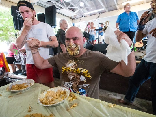 The annual MangoMania always includes a pie-eating contest.