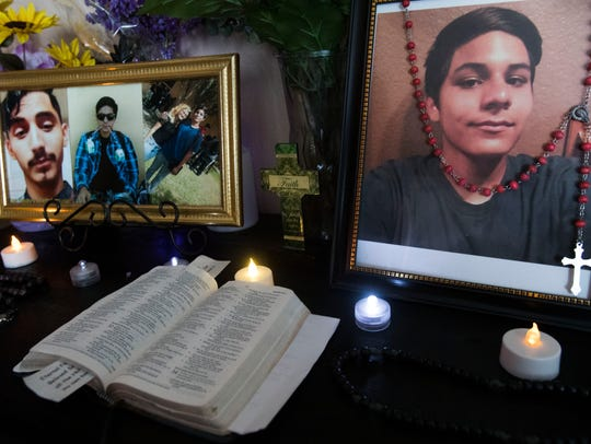 A shrine in honor of Jacob Carrillo, at right, sits