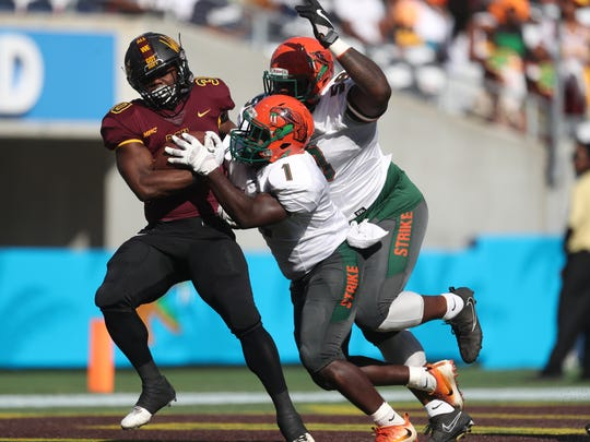 FAMU's Terry Jefferson, center, and Emilio Gibbs take down Bethune-Cookman's Jamaruz Thompkins during the Rattlers 29-24 Florida Classic loss at Camping World Stadium in Orlando Saturday, Nov. 18, 2017.