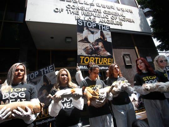Animal activists including Priscilla Presley (2R) and