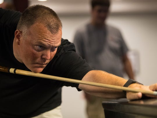 Dan Jarrell plays pool at the Slate Cafe in Smyrna on Monday, July 16, 2018. Jarrell is the captain of the state's Masters championship team and will travel with other players to Las Vegas for the American Poolplayers Association World Pool Championships at the Westgate Las Vegas Resort & Casino in August.