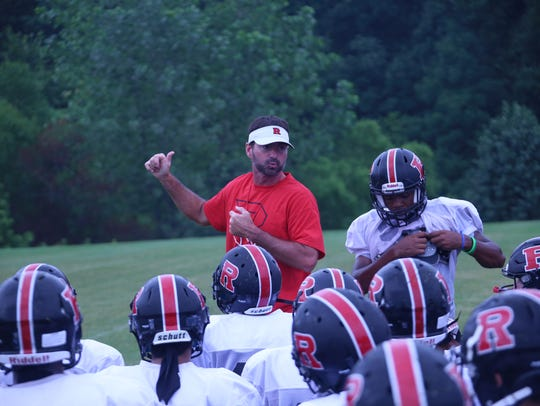 Rossview coach Todd Hood talks with his team just before it sets out for practice Monday during the first day of full pads.
