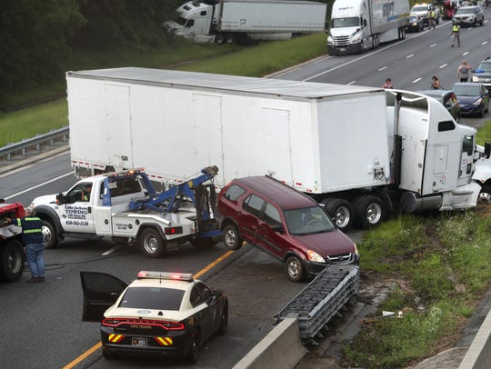 A multi-car accident shuts down Interstate 10, causing