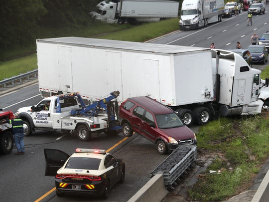 A multi-car accident shuts down Interstate 10, causing gridlock in both directions near the Monroe Street exit on Tuesday, July 24, 2018.