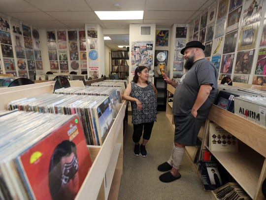 Jim Gibson and his wife, Eileen, in their record shop,