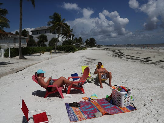 Jason Buster and his daughter Madisyn,15, enjoy Fort Myers Beach on Tuesday 7/24/2018. They are renting a home on across Estero Boulevard.