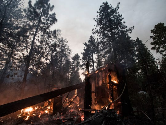 The Cranston Fire swept through this neighborhood in Idyllwild, California, burning structures Wednesday, July 25, 2018.