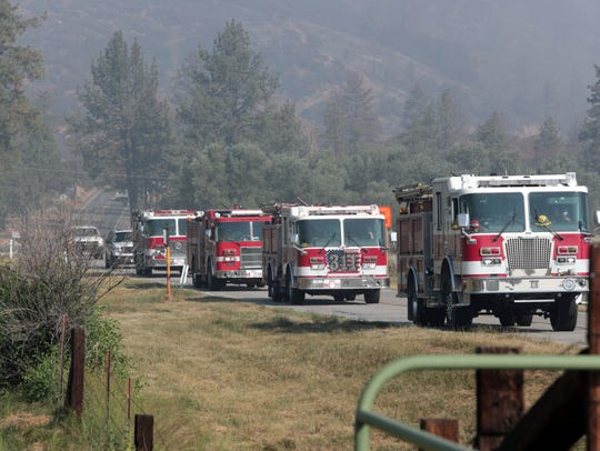 A convoy of fire trucks at Lake Hemet during the Cranston
