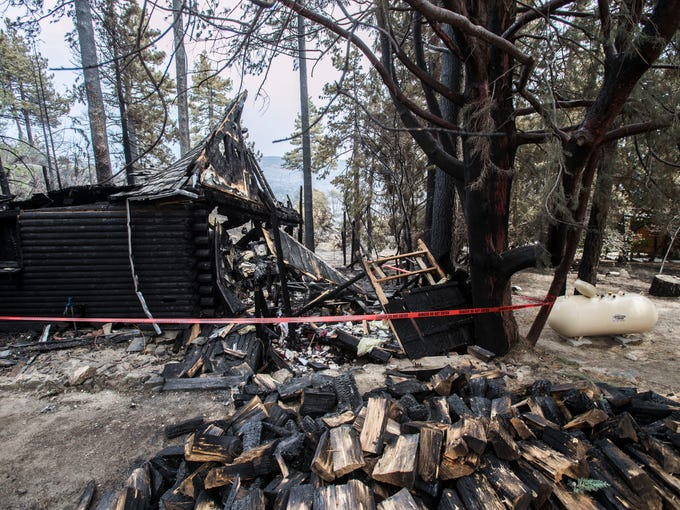 A home that was destroyed in the Cranston Fire is taped
