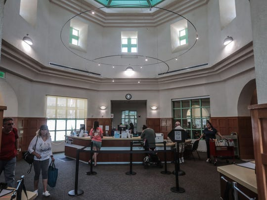 People checkout books at the La Quinta Public Library