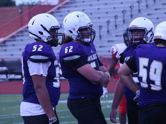Clarksville High's offensive line wait for a play to