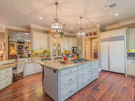 The kitchen in the 4 bedroom, 2½ bathroom home in Broussard, Louisiana, is a gourmet cook's dream. The mansion is listed at $879,900.