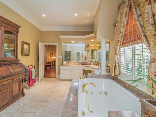 The master bath in the 4 bedroom, 2½ bathroom home in Broussard, Louisiana, is beautifully appointed for ultimate pampering. The mansion is listed at $879,900.
